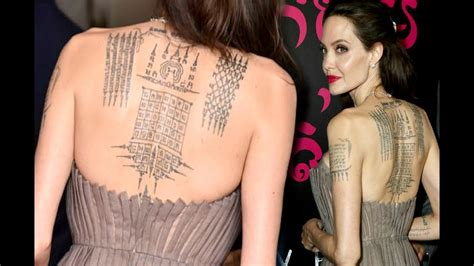 angelina jolie gun tattoo angelina jolie flaunts her back tattoo at her film first