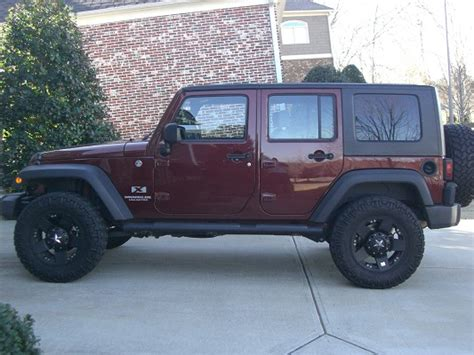 burgundy jeep 2009 jeep wrangler 25 000 100464736 custom lifted