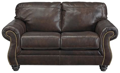 leather loveseat with nailhead trim signature design by ashley bristan traditional leather