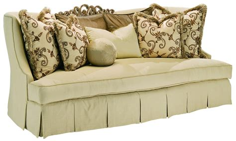wooden carved sofa sofa in a lux cream fabric with hand carved wooden details