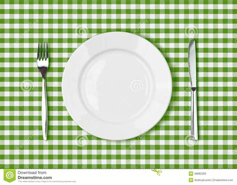 Green Table Settings - knife white plate and fork on green picnic table cloth stock photos image 36882393