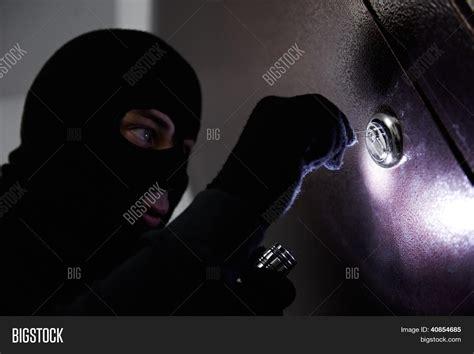 house breaking thief burglar opening metal door image photo bigstock