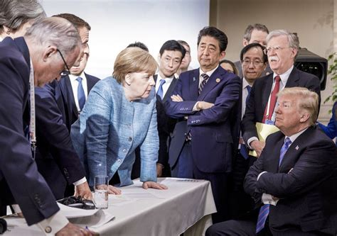 viral photo  angela merkel  donald trump sums