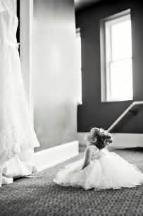 honeyfund wedding justlove flower girl looking at the wedding dress just this