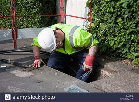 a bt openreach telecommunications technician working in a