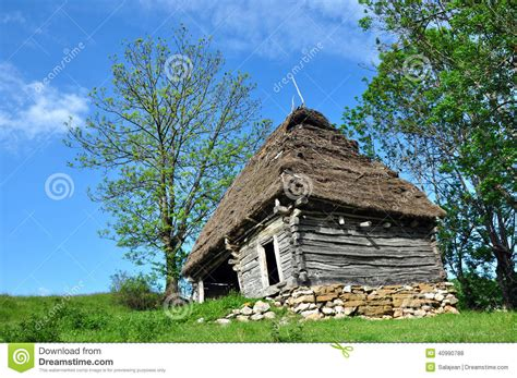 old log barn stock photos image 16113943 old log barn with a thatched roof royalty free stock