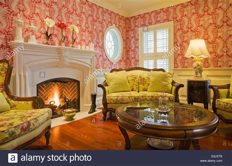 fireplace chairs lit gas fireplace yellow flowery upholstered chairs sofa