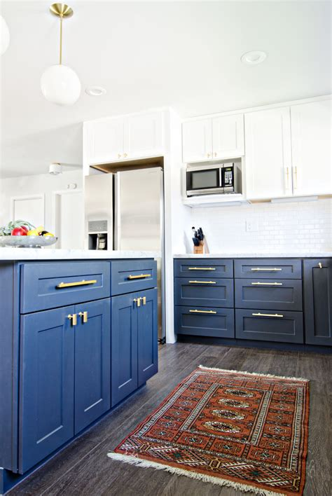 navy cabinets navy gold white kitchen reveal the vintage rug shop