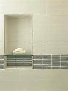 contemporary bathroom with beige tile and inset glass shelf