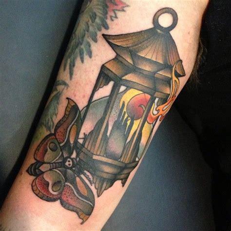moth and lantern tattoo by amanda leadman tattoomagz
