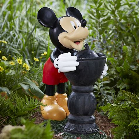 disney mickey taking a drink outdoor living outdoor decor fountains pumps