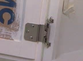 How To Install Kitchen Cabinet Hinges How To Install And Level Cabinet Doors How Tos Diy