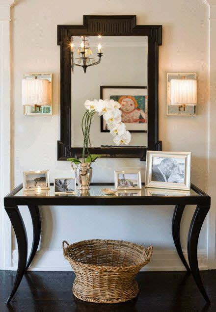 Entrance Tables And Mirrors Chic Foyer With Black Mirrored Top Console Table With Wicker Basket Paired With Black Fretwork