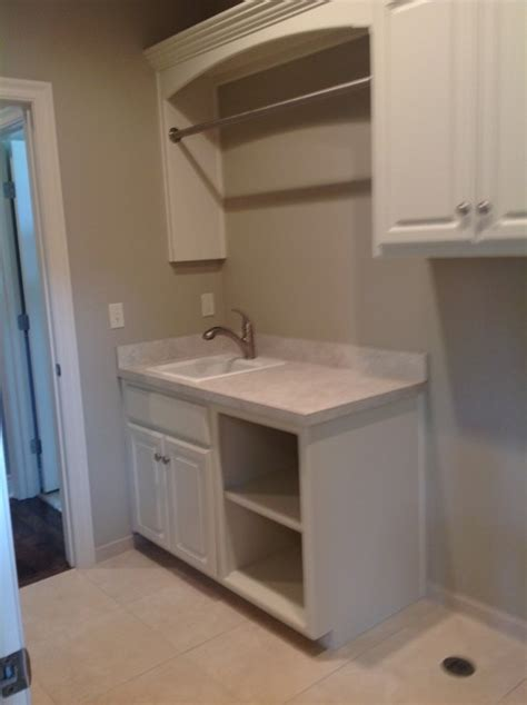 laundry room cabinets with hanging rod laundry room like sink cabinets and hanging rod