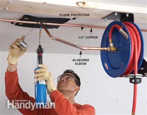 air hoses install a retractable air hose reel the family handyman