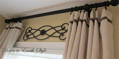hanging curtains high curtains i hang the curtain rods as high as possible to accentuate ceiling height these