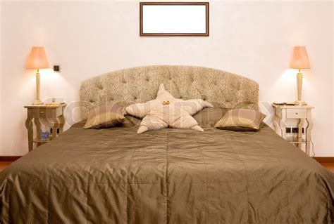 big bed bedroom in which there is a big bed with a coverlet of