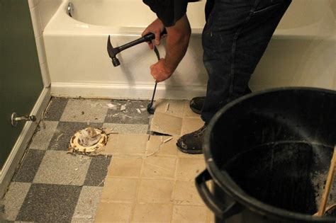 how to replace a bathroom floor how to remove a tile floor how tos diy