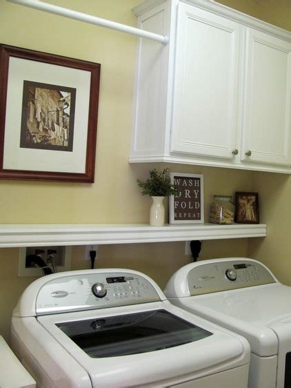 top 25 ideas about washer dryer cover up on pinterest hidden laundry washers and plugs traditional top loading washer dryer set up shelf