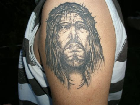 jesus tattoo on bicep jesus tattoos for men ideas and inspiration for guys