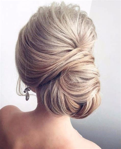 hair style up in one wedding hairstyle for long hair side chignon bun updo