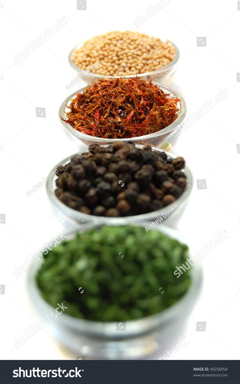 Small Glass Containers For Spices Four Small Glass Containers Filled With Spices