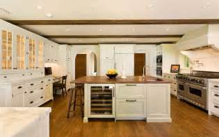 white kitchen with wood countertop island hooked houses via decorpad