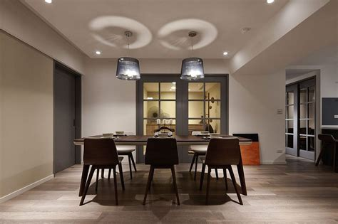 modern pendant lighting for dining room dark sophistication thirty year old apartment embraces a
