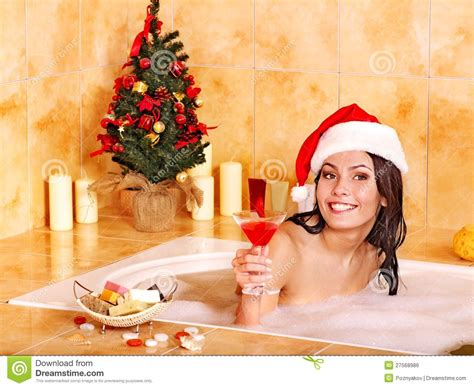 santa in a bathtub woman in santa hat relax in bath royalty free stock image