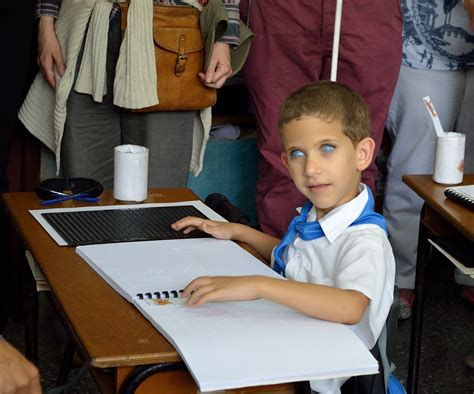 teaching blind children a cuban school for the blind of promise for the