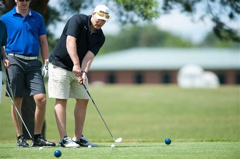 hockey golf swing images from the michigan hockey alumni golf outing