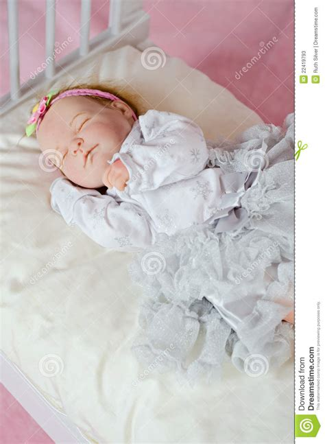 how to dress baby for bed sleeping newborn doll girl stock photos image 22419793