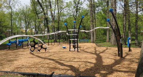 the swings of central park portage installs new playgrounds at two parks mlive com