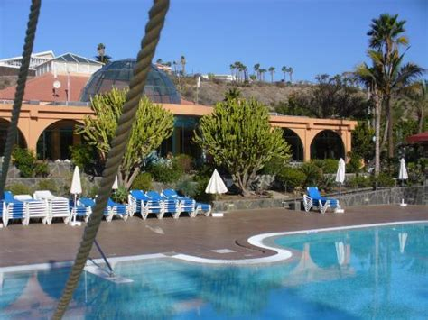 cay princess bungalows maspalomas pool and restaurant with bright blue sky