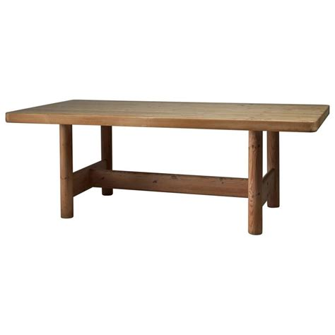 large pine dining table by architects friis and