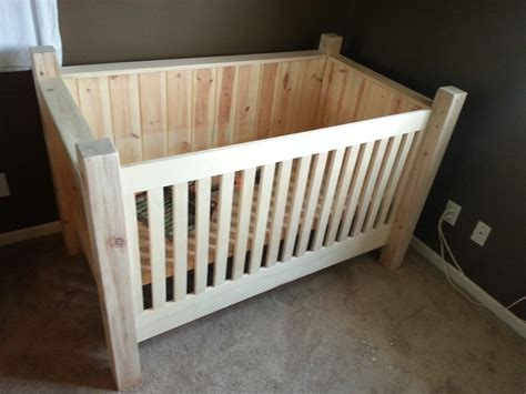 Handcrafted Baby Cribs - rustic nursery area using simple diy baby crib with wood