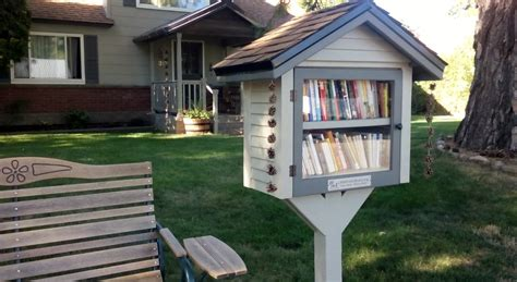 tiny library reading in the garden little free libraries coeur d