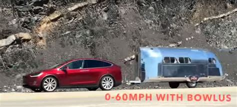 tesla model x towing a trailer would still beat most