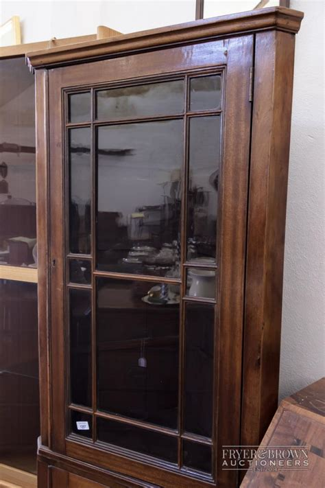 Glass Door Corner Cabinet A Mahogany Corner Cabinet With Glass Door Above Cupboar