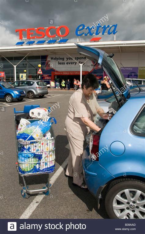 Tesco Extra supermarket store car park mature woman