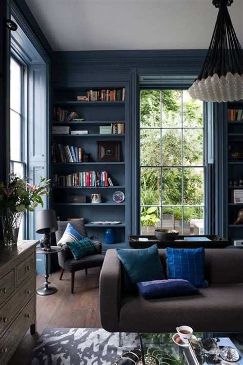 dark blue living room walls a dark moody living room books in the home pinterest