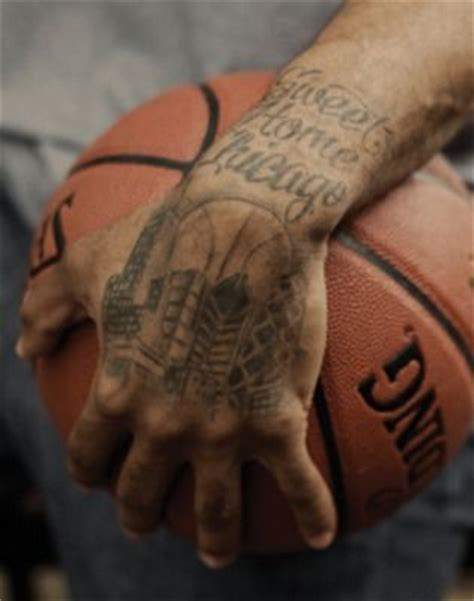 derrick rose poohdini tattoo chicago skyline with basketball in the background derrick
