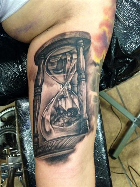 man trapped in hourglass by max egy tattoonow