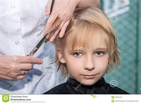 how to get l haircut young boy getting a haircut stock photo image 43344751