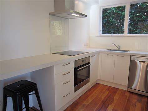 Pictures Of Kitchen Designs white doors white benchtop timber flooring kitchens 2 go