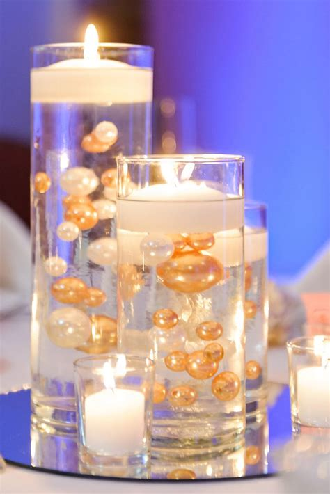wedding centerpieces with candles and pearls floating candle centerpieces with gold and white pearls