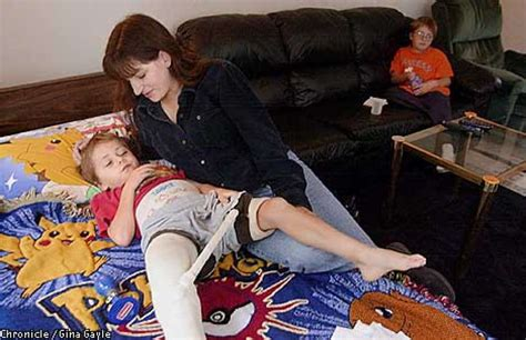 mom and son have in livingroom after son s injury single mom struggles to keep a