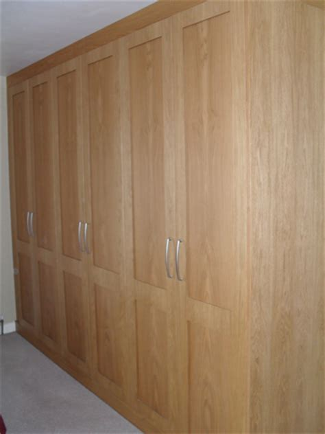 Oak Fitted Wardrobes by Rooms Reborn Property Maintenance Bedroom Design And