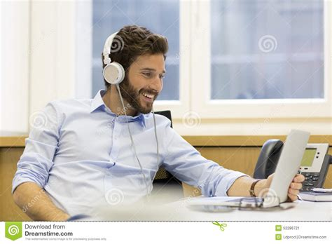 cheerful listening and using computer in modern