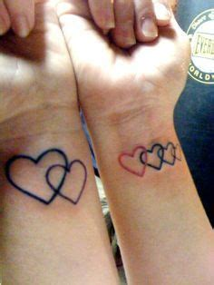 tattoos of four interlinked hearts google search